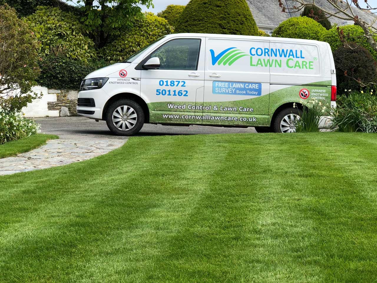 Cornwall Lawn Care van park at client's property next to perfect weed free grass